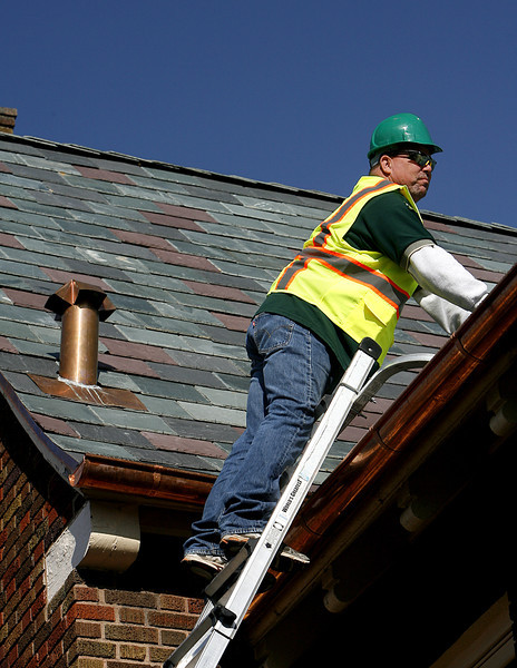 Danny Bilby, Project Manager for A-Best Roofing, does a final inspection of a recent roofing project in Tulsa.