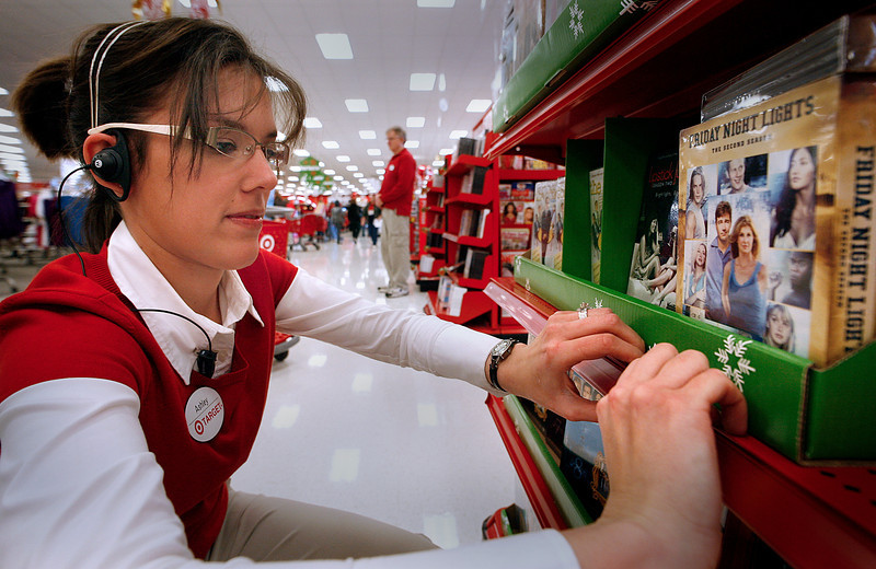 On Black Friday in Tulsa Target store Employee Ashley Cargill helps redistribute a display of Movies DVDís shoppers had nearly emptied during the first day of Christmas shopping.