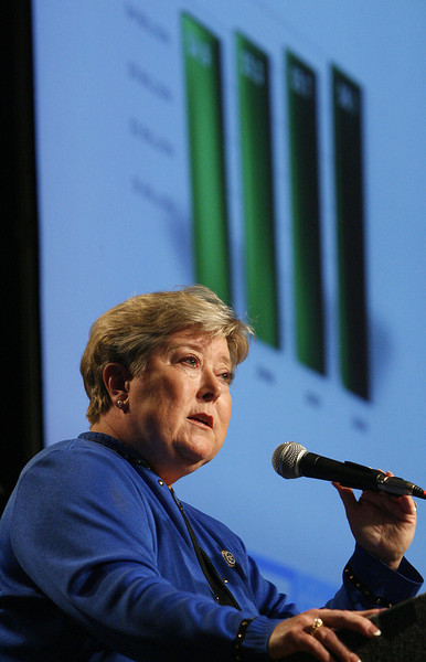 Shown on a graph behind her Lieutenant Governor Jari Askins announces the latest record-breaking tourism economic impact numbers for Oklahoma when she opened the 2009 Governor's Conference on Tourism in Tulsa.