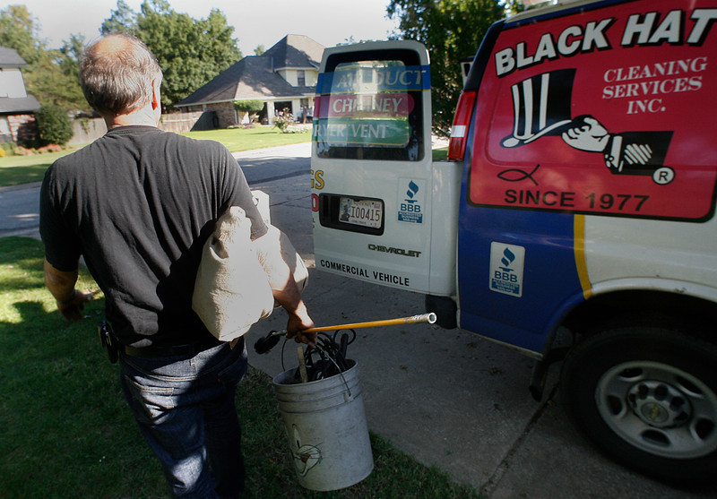 David Harris of Black Hat Cleaning Services Packs up after cleaning a chimney in South Tulsa.Harris has been a chimney sweep for about 30 years.