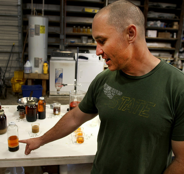 Randy Kimberlin, Co-Owner of Tulsa BioFuels, with a sample of raw cooking oil his company separates to make Bio-Diesel.