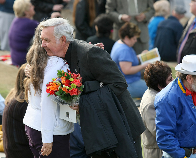 Calvin Moser, survivor of the 1995 attack on the Murrah building, receives a hug from another visitor to the 15th Anniversary Rememberance Ceremony at the Oklahoma City National Memorial Monday. PHOTO BY MAIKE SABOLICH