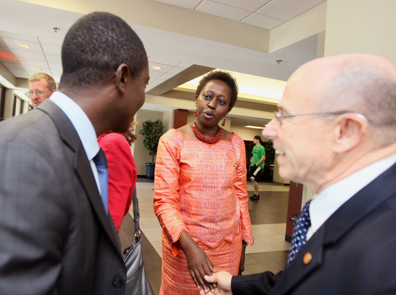 Dr. Aisa Kirabo Kacyira, mayor of Kigali, middle, greets Oklahoma Christian University  draduate student John Nkuranga and OC president Mike O'Neil before the Sister City Luncheon Thursday. PHOTO BY MAIKE SABOLICH