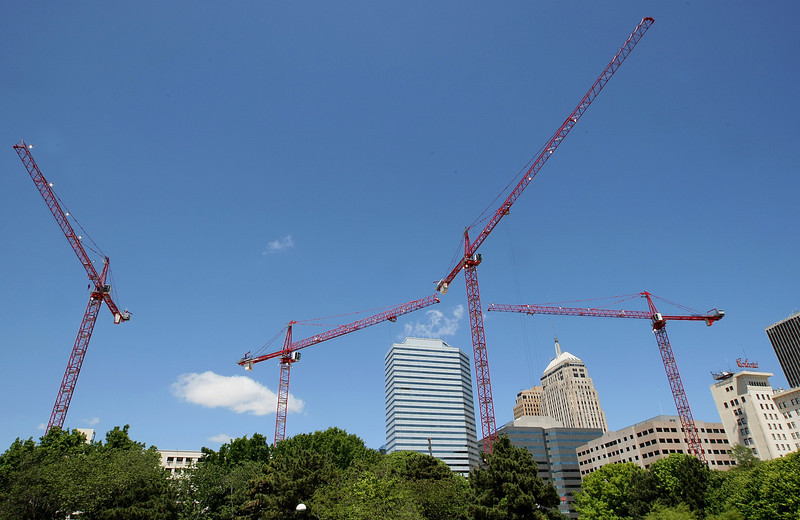 Cranes from the Devon construction site as seen from the Myriad Gardens. PHOTO BY MAIKE SABOLICH
