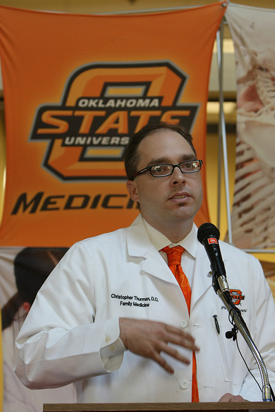 Dr. Christopher Thurman speaks to the crowd during the grand opening for the new OSU Physicians Clinic at Eastgate Metroplex Thursday.