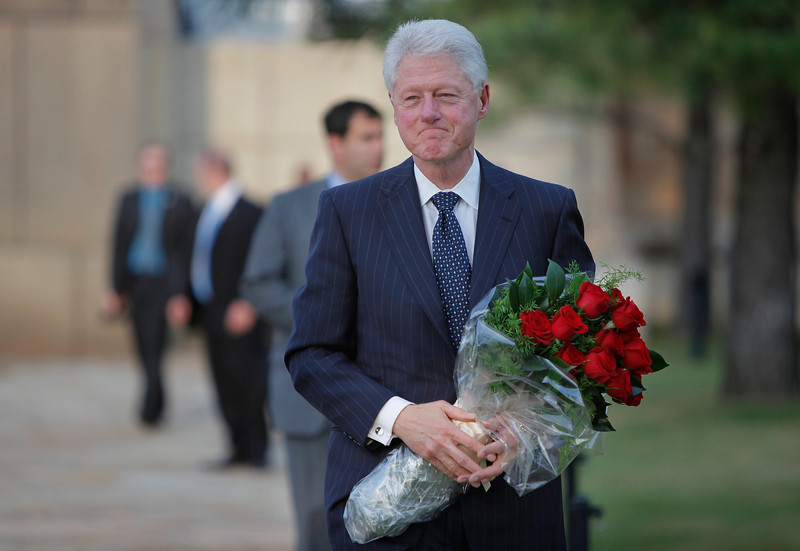 Former President Bill Clinton is pictured as he visits the Oklahoma City National Memorial in Oklahoma City, Wednesday, April 21, 2010. Clinton is in town to accept the sixth annual Reflections of Hope Award for his work in helping Oklahoma City transform following the bombing of the Alfred P. Murrah Federal Building 15 years ago and for his international peace work during his presidency and over the past decade. (AP Photo/Bryan Terry, Pool)