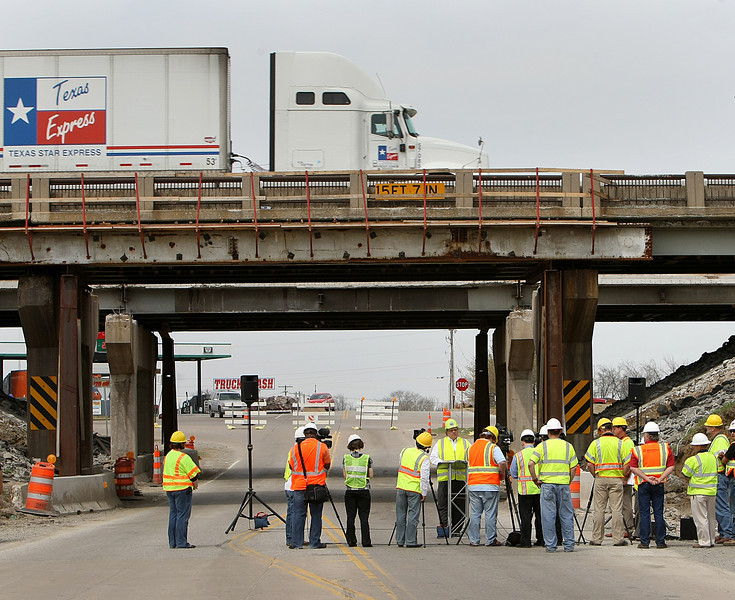 Members of the press at a press conferences that ODOT used to inform the public that emergency repairs to the I-44 bridge over 161 East Ave in Tulsa are complete.