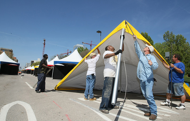 Tyrone Mays, Larry White, Tom Cook and other Event Production Incorporated employees set up tents for the Arts Festival next week. PHOTO BY MAIKE SABOLICH