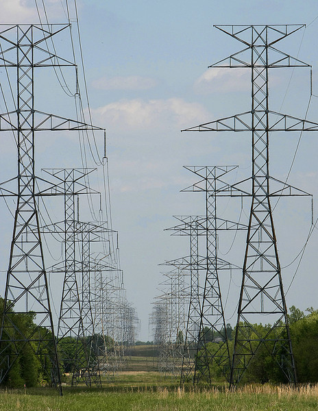 Power transmission Lines such as these in Bixby are going to be constructed to support the wind farms in Western Oklahoma.
