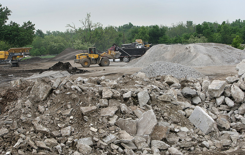 Loaders fill dump trucks with recycled concrete at ReRock in North Tulsa.