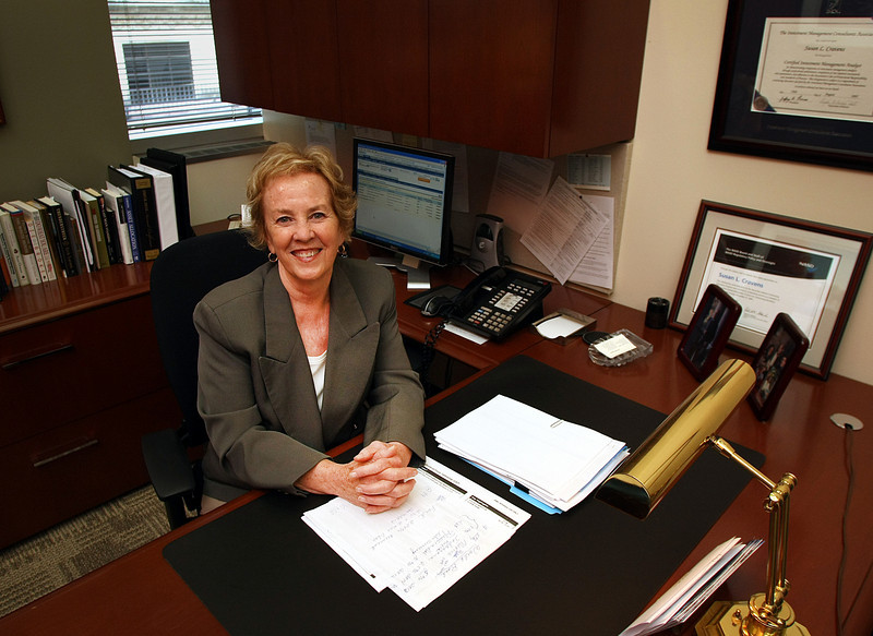 Susan Cravens, Vice President with J.P. Morgan Chase Bank, at her desk in Tulsa.