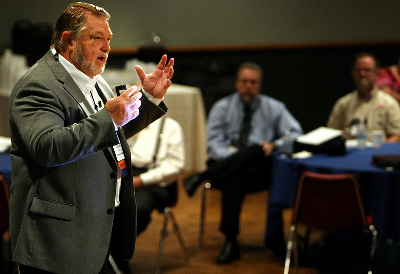Chuck Tyron gestures while delivering his program at the Knowledge and Project Management Symposium in Tulsa.