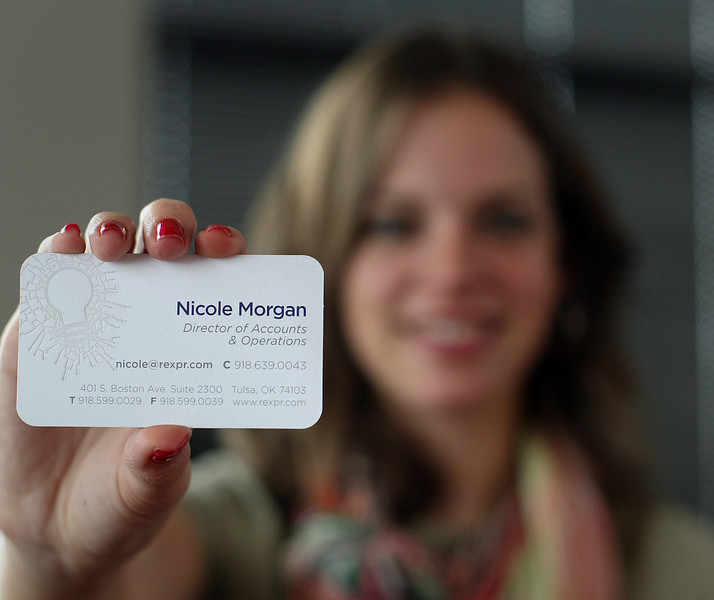 Nicole Morgan, Director of Accounts & Operations at Rex Public Relations, holds her Business card.