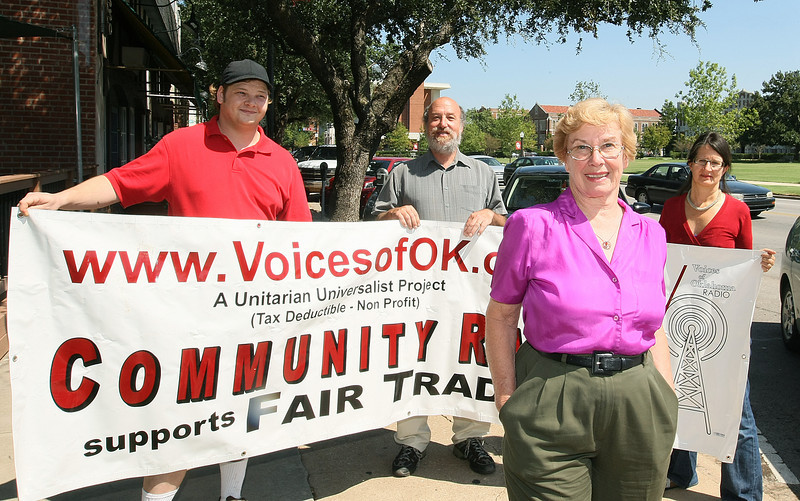 Mary Francis, founder of Voices of Oklahoma and the community radio station FM 89.7. In the background: Board Secretary Casey Holcomp, Board Treasurer Michael Givel and Board Member Clemencia Rodriguez. PHOTO BY MAIKE SABOLICH