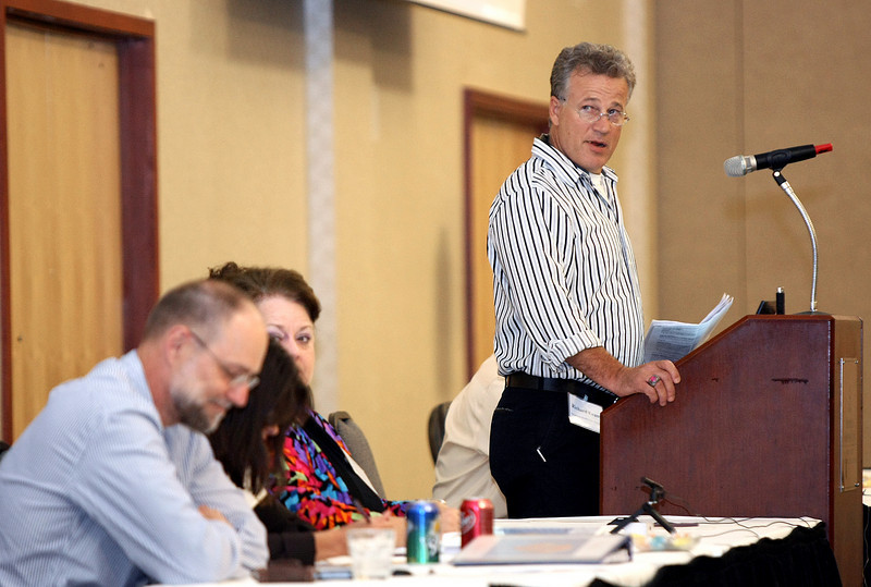 Richard Evans, eligibility automation and data integrity manager with the Oklahoma Health Care Authority, discusses online enrollment for Sooner Care Thursday during the OHCA's annual board retreat at the Redd Center.  PHOTO BY MAIKE SABOLICH