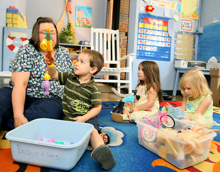 Miss Lori Hays, Trent Morris, Lauren Burke and Tori Greenwald play before lunch time at St Luke's United Methodist Church Child Development Center Wednesday. The cost of providing child care in Oklahoma is going up, which means parents are facing higher rates as well. PHOTO BY MAIKE SABOLICH