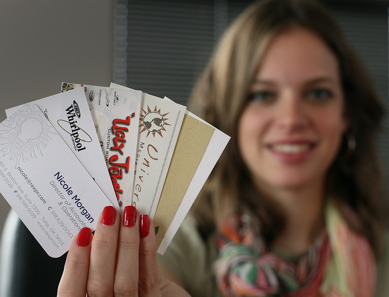 Nicole Morgan, Director of Accounts & Operations at Rex Public Relations, holds a few of the many business cards she keeps.