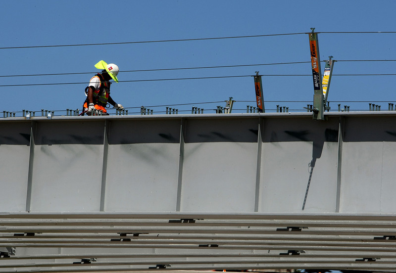 A workman repairs a bridge on the Inner Dispersal Loop near downtown Tulsa.
