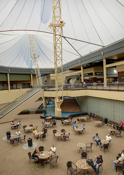 Employees relax in the atrium of the Eastgate Metroplex in Tulsa.