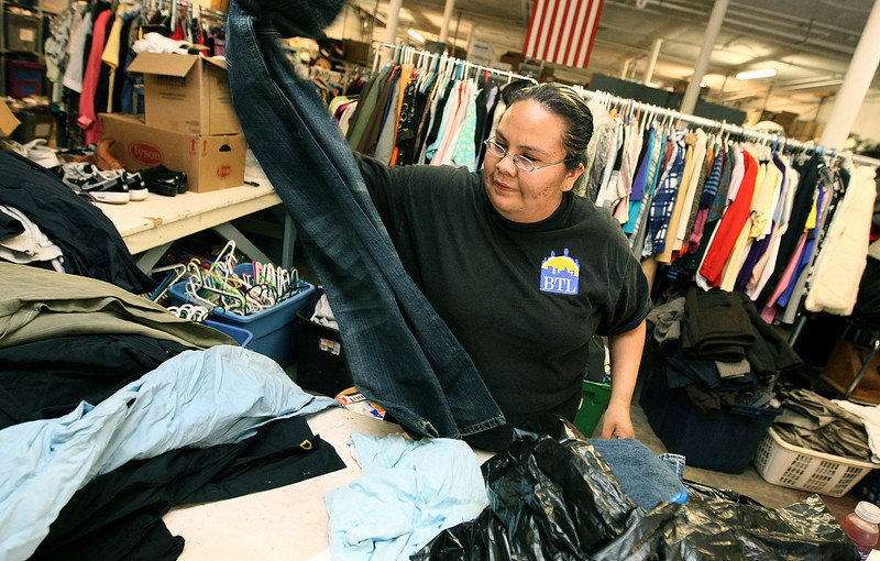 Clarissa Scott works at City Rescue Mission's donation warehouse Monday. PHOTO BY MAIKE SABOLICH
