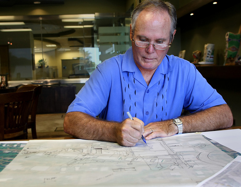 Keith Franklin, President of Landplan Consultants in Tulsa, works on plans for a revitalization of downtown Pawhuska.
