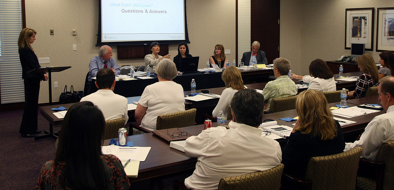 The panel answers questions during the Healthcare Reform Business Forum seminar in Tulsa.
