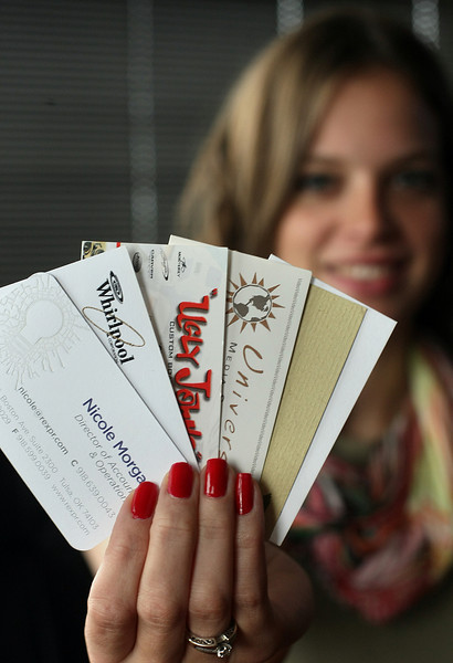 Nicole Morgan, Director of Accounts & Operations at Rex Public Relations, holds an few of the many business cards she keeps.