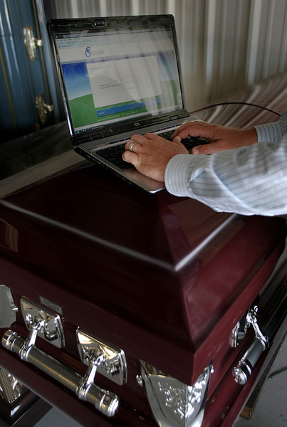 Jason Reed, Director of Operations for Cremation Safeguard LLC, uses new software developed by the company to track a body from funeral home to crematorium to assure the proper person is being cremated.