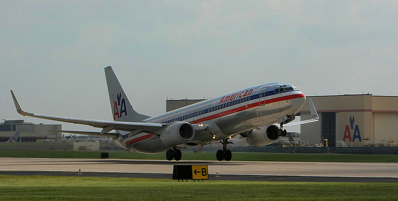 With the maintenance hangers in the background An American Airlines 737 departs Tulsa International Airport.