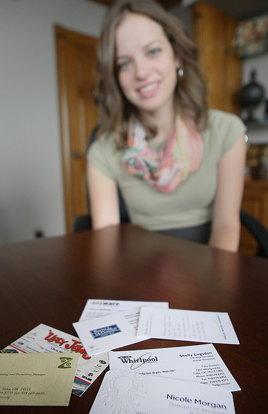 Nicole Morgan, Director of Accounts & Operations at Rex Public Relations, with a few of the many business cards she keeps.