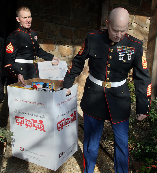 First Sergeant William Ranster and Sergeant Jared Terrell of the United States Marines pick up boxes of toys from Tulsa based  CS3 Technology, a drop zone for the Toys for Tots program.