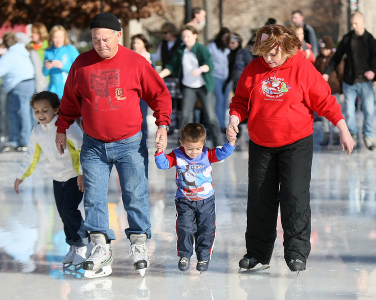 Isabela Portillo,7, John Farquharson, Alexander Portillo, 3 and Diane Portillo are skating at the Devon Ice Rink Wednesday. PHOTO BY MAIKE SABOLICH