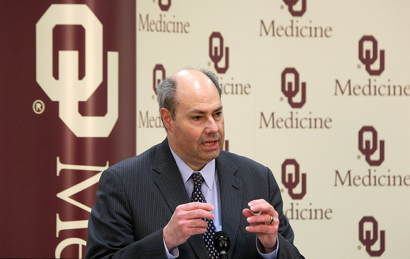 Dr. Gary Raskob. dean of th4e OU College of Public Health, reports major findings in prevention and treatment of life-threatening blot clots Wednesday during a press conference. PHOTO BY MAIKE SABOLICH