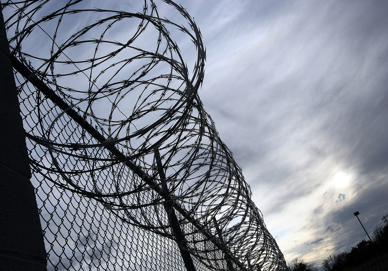 Barbed wire on top of correctional facility fence. PHOTO BY MAIKE SABOLICH