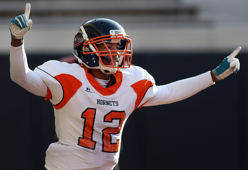 Booker T Washington's Tyler Locket celebrates a touchdown during the 5A Championships held in Stillwater this past Saturday.  Booker T Washington won the contest against East Central in a 32 – 3 game.