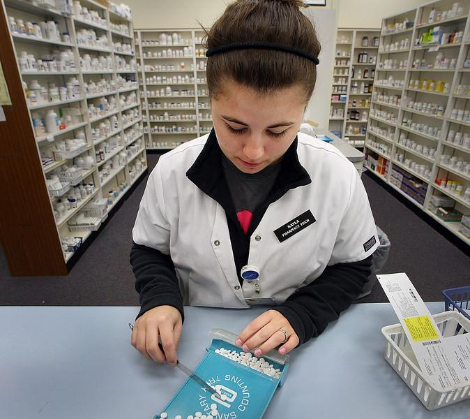 Pharmacy Tech Kayla Noe fills prescriptions at the Spoon Pharmacy in Sand Springs.