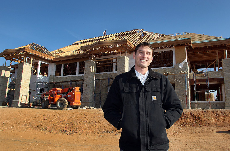 Jason Sheffield, General Manager of the Shangri-La Country Club in Afton, stands in front of the new club house under construction on Monkey Island.