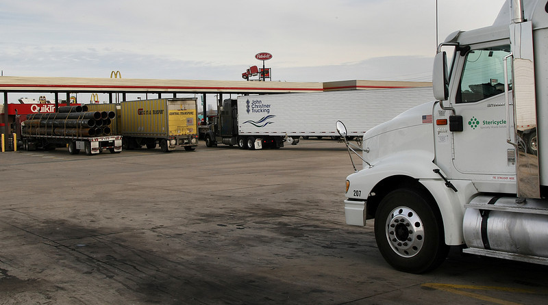 Trucks drivers fuel vehicles and take a break at the QT Truck stop on the Turner Turnpike in West Tulsa.