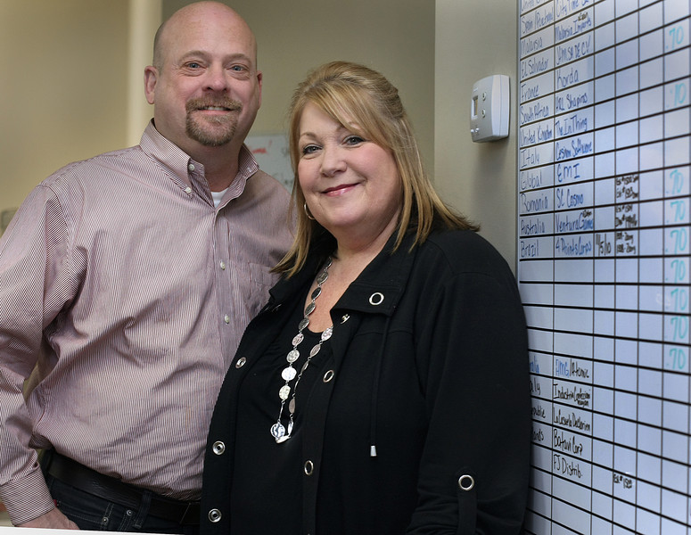 Partners of Big Time Brands Jim Howard and Lori Montag in their Broken Arrows office.
