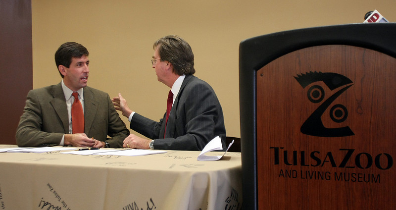 Tulsa Zoo Management Board President Phil Lakin, Jr and Tulsa Mayor Dewey Bartlett sign the document creating an agreement between Tulsa Zoo Management, Inc. and the City of Tulsa for the management and care of the zoo.