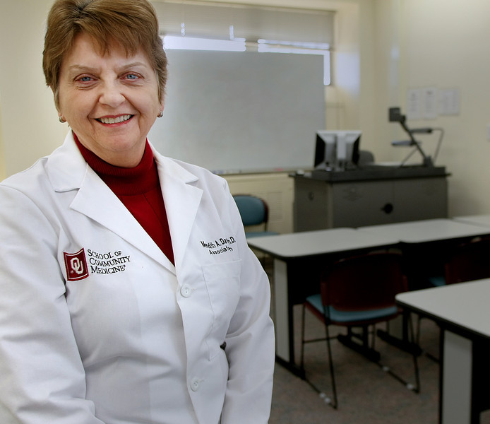 Meredith Davison, Associate Dean for Academic Services at the University of Oklahoma School of Community Medicine in Tulsa pauses for a photo in one of the schools classrooms.