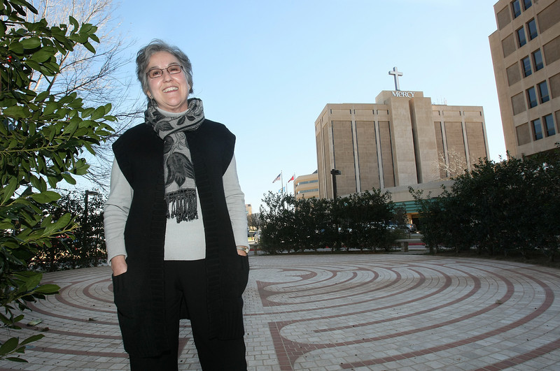 Marilyn Geiger. president of philanthropy with Mercy Health System of Oklahoma in front of Mercy's labyrinth. PHOTO BY MAIKE SABOLICH