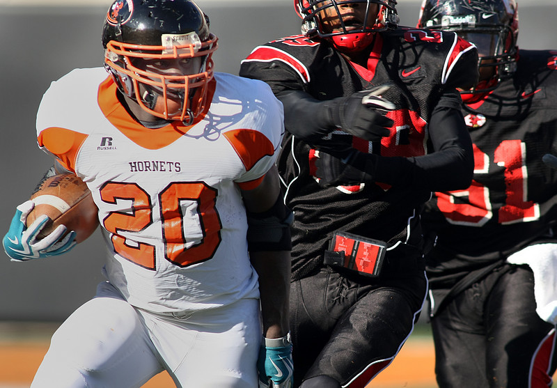 Booker T Washington running breaks free from defenders during the 5A Championships held in Stillwater this past Saturday.  Booker T Washington won the contest against East Central in a 32 – 3 game.