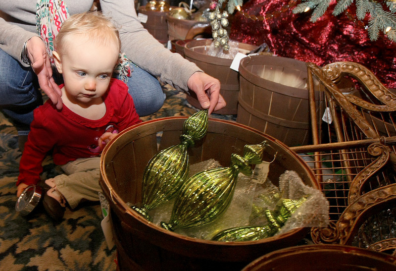 Jolie Yaekley checks out Christmas ornaments at North Pole City Wednesday. PHOTO BY MAIKE SABOLICH