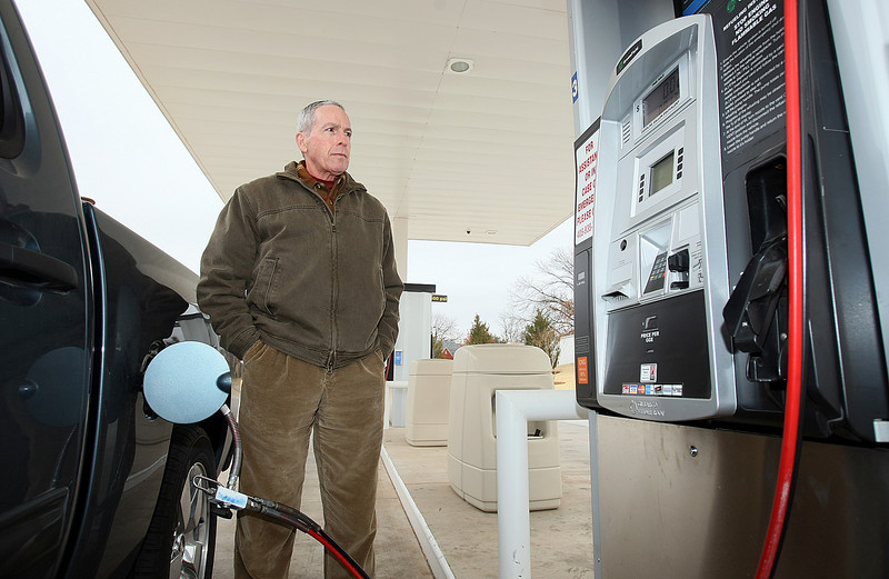 Mark Thompson fills up hius car with natural gas at a filling station on Western Thursday. PHOTO BY MAIKE SABOLICH