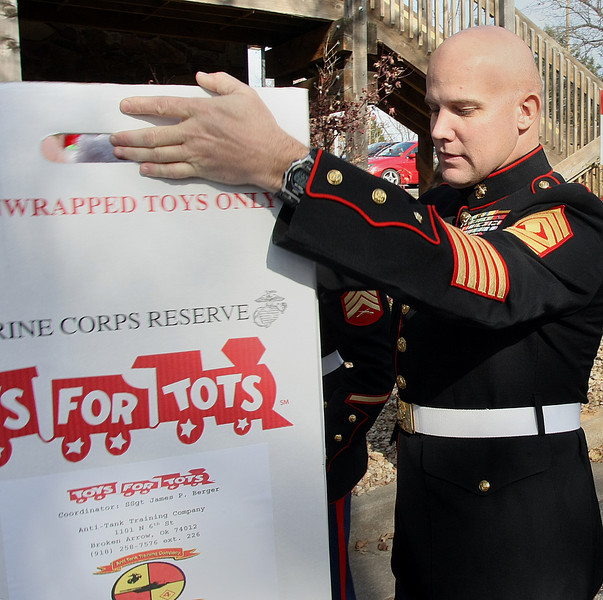 First Sergeant William Ranster of the United States Marines secures boxes of toys picked up from Tulsa based  CS3 Technology, a drop zone for the Toys for Tots program.