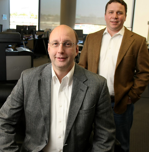 True Digital Security CEO David Humphrey and Co-Founder Alex Pezold pause for a photo in their Tulsa office.