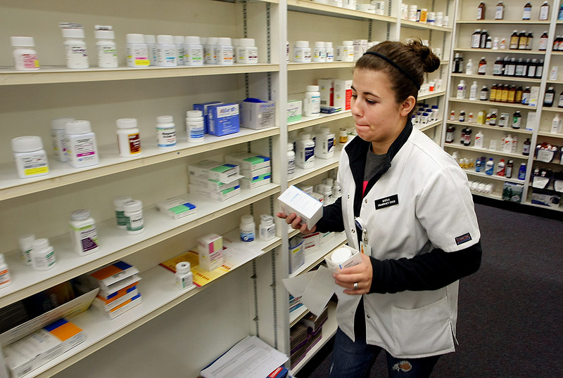 Pharmacy Tech Kayla Noe fills prescriptions at the Spoon Pharmacy in Sand Springs.
