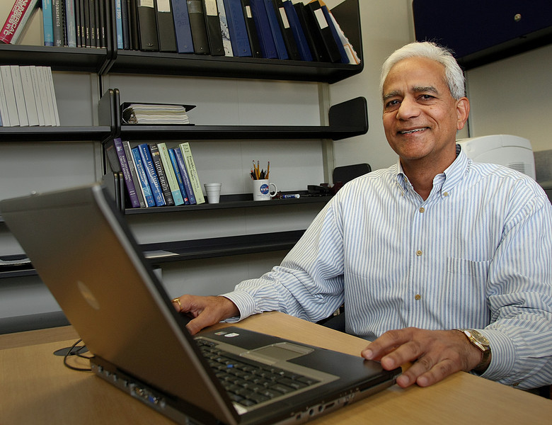 Dr. Surendra Singh, Professor at the University of Tulsa's Department of Electrical Engineering, works in his office.
