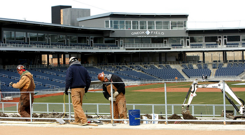 Workmen are in the later stages of construction at the OneOk Ballpark and preparing it  for opening day in Spring.
